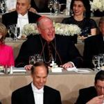 Democratic U.S. presidential nominee Hillary Clinton (L-R), Archbishop of New York Cardinal Timothy Dolan and Republican U.S. presidential nominee Donald Trump sit together at the Alfred E. Smith Memorial Foundation dinner in New York, U.S. October 20, 2016. REUTERS/Jonathan Ernst TPX IMAGES OF THE DAY